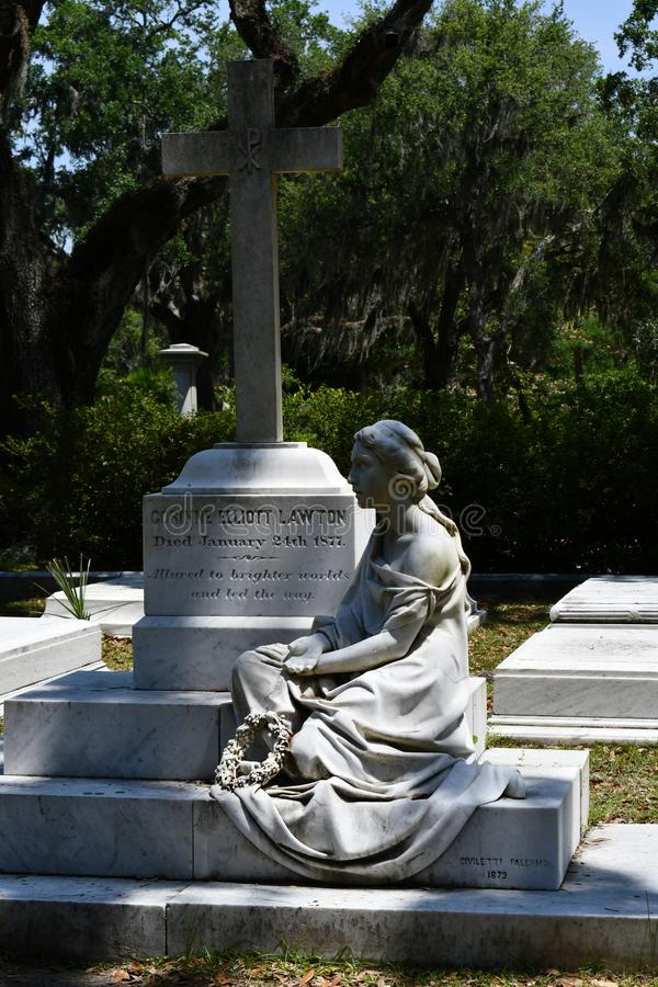 Cemetery Headstone at Savannah Georgia historic cemetery. Granite cross headstone featured at the oldest cemetery in Savannah Georgia, surrounded by trees royalty free stock images