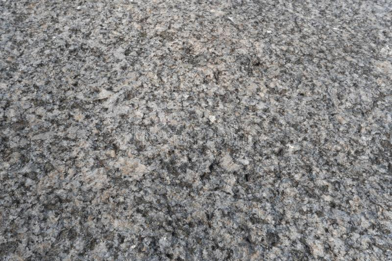 Granite crumb texture. Non polished white granite as a background, texture for illustration. Granite crumb texture. Grey gritty rock surface. Non polished white royalty free stock images