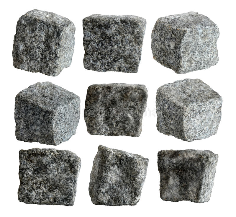 Granite cubes. Nine granite pavement cubes isolated with path on white background stock image