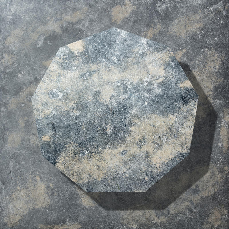 Granite dark polygon. Granitepolygon with shadow isolated on dark stone background, flat lay royalty free stock images