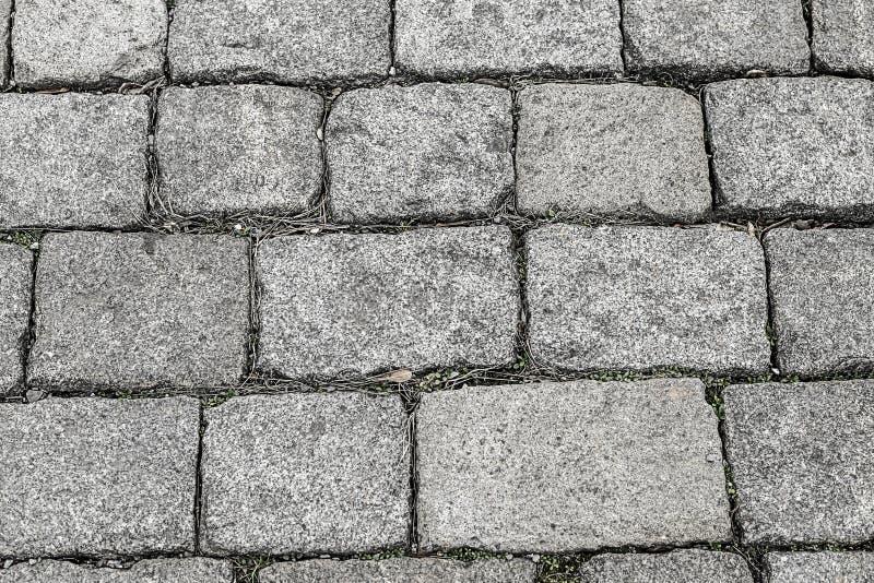 Granite gray blocks rectangular stones garden path hard background base row cobblestone pattern hard royalty free stock images