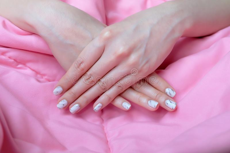 Granite Gray Nail. Close Up Nails Polish, Manicure Granite Gray Nail on Pink Blanket Background stock image