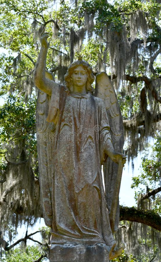 Cemetery Headstone at Savannah Georgia historic cemetery. Granite headstone with angel featured at the oldest cemetery in Savannah Georgia, surrounded by trees royalty free stock photography