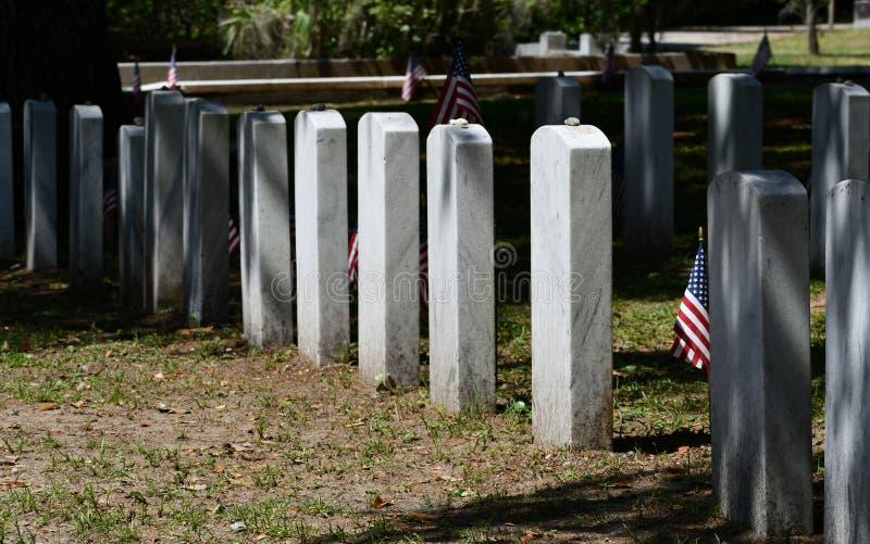 Cemetery Headstone at Savannah Georgia historic cemetery. Granite headstones honoring fallen soldiers featured at the oldest cemetery in Savannah Georgia stock photo