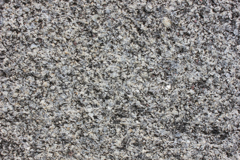 Granite. Monolith surface from the gray natural processed granite royalty free stock image
