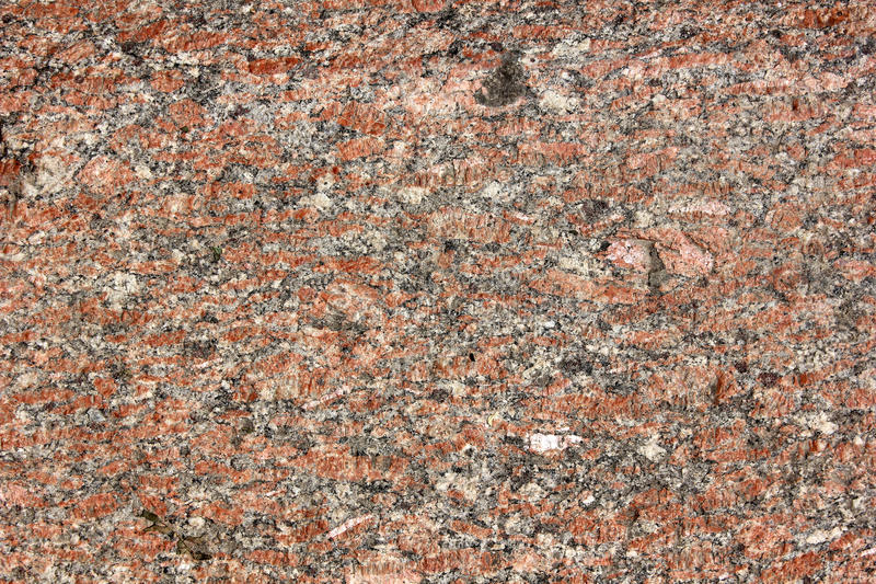 Granite. Monolith surface from the pink natural processed granite stock image