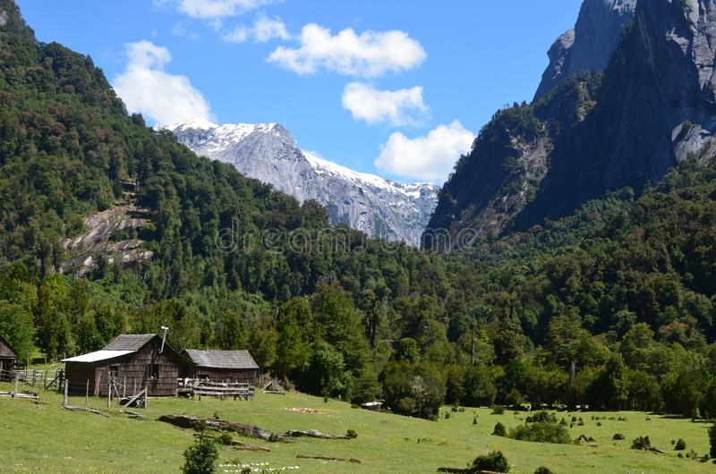 Granite mountains in the Cochamó Valley, Lakes Region of Southern Chile. The Cochamó valley in Chile`s Lakes region Los Lagos offers spectacular mountain stock photography