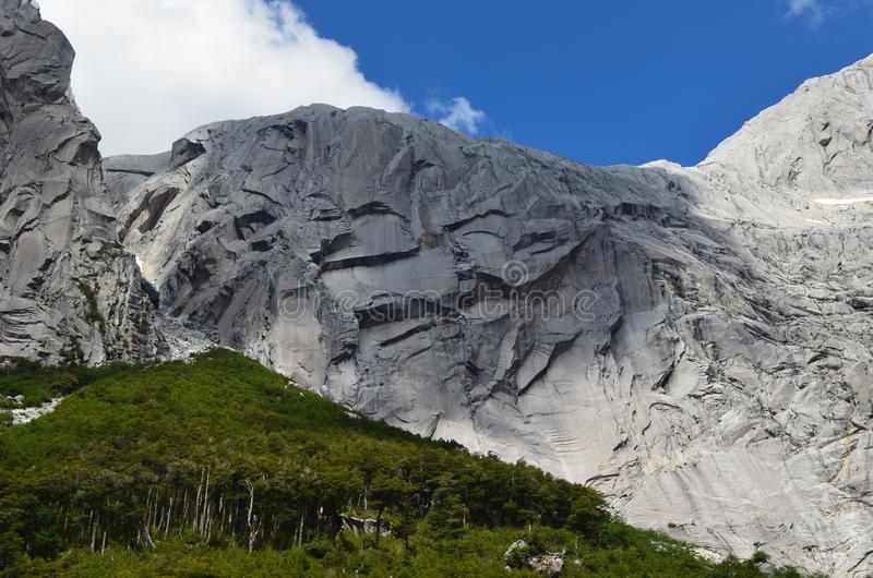 Granite mountains in the Cochamó Valley, Lakes Region of Southern Chile. The Cochamó valley in Chile`s Lakes region Los Lagos offers spectacular mountain stock photo