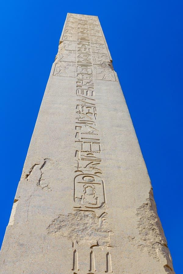 Granite obelisk against blue sky in a Karnak temple. Luxor, Egypt. Granite obelisk against blue sky in Karnak temple. Luxor, Egypt royalty free stock photography