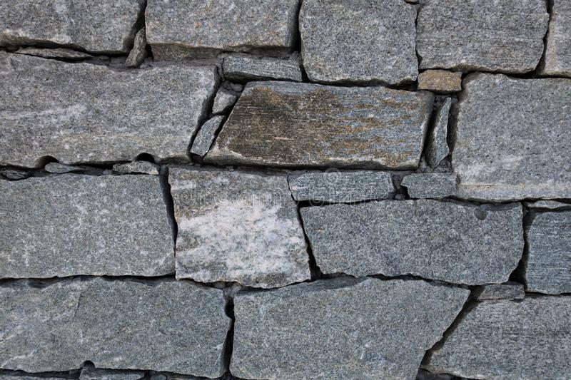 Granite rock blocks joined together forming wall in mountain ref. Close-up of granite rock blocks joined together without mortar forming a wall of alpine royalty free stock photo