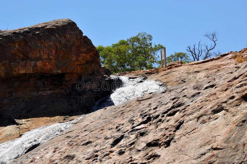 Granite Rock Face at Serpentine Falls. Granite rock face with a trickling waterfall at Serpentine Falls in Serpentine National Park in Western Australia royalty free stock images