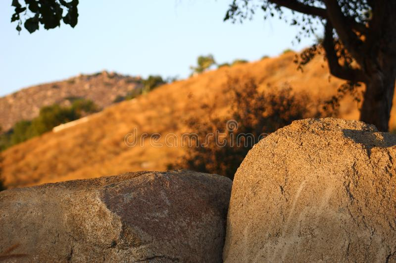 Carved rocks together in the sunset stock images