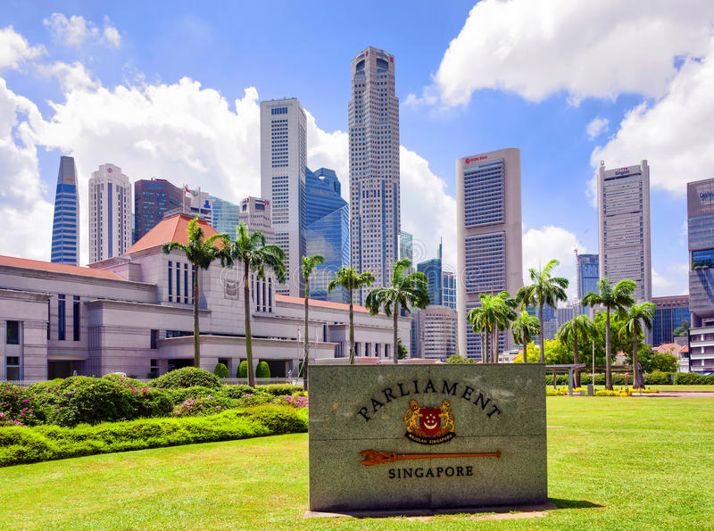 Granite sign and Parliament house building in Singapore royalty free stock image