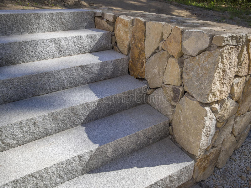 Close Up Of Granite Stairs With Rock Retaining Wall