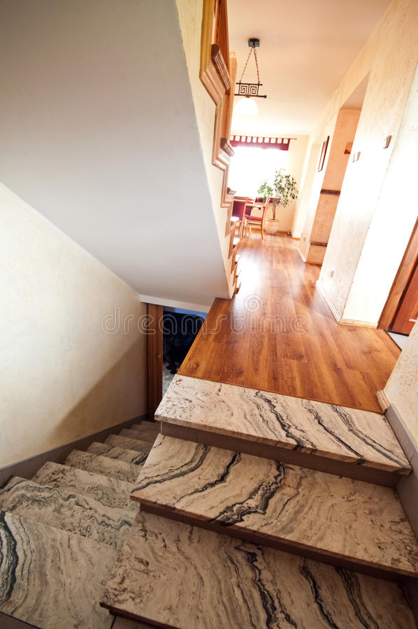 Granite steps and wooden floor royalty free stock photos