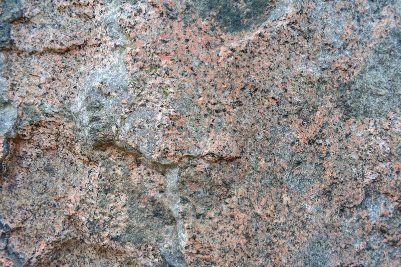 Granite stone texture. The texture of the granite stone is pink. Relief sad background royalty free stock photography