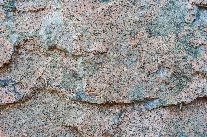 Granite stone texture. The texture of the granite stone is pink. Relief sad background royalty free stock image