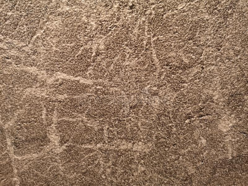 Granite stone wall gray color rough surface texture material background royalty free stock photography