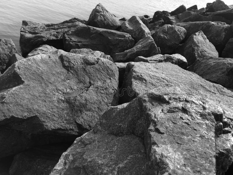 Granite stones on the seashore. Black-and-white photo. Contrasting, good texture. Nature pattern royalty free stock photo