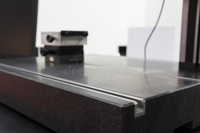 GRANITE SURFACE PLATE in CMM machine. Close up stock image