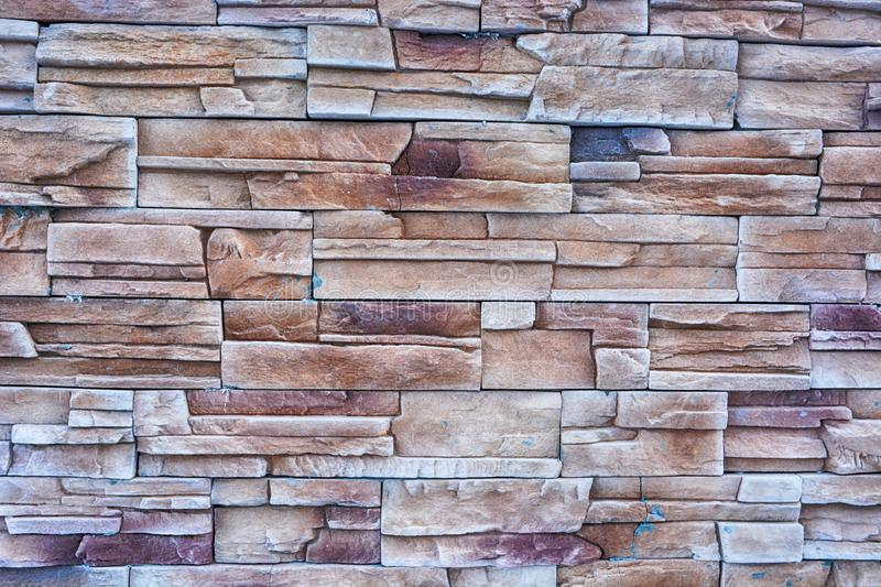 Granite texture brick wall. Close up of modern style design. Stone wall surface. Background for your concept or project royalty free stock photography