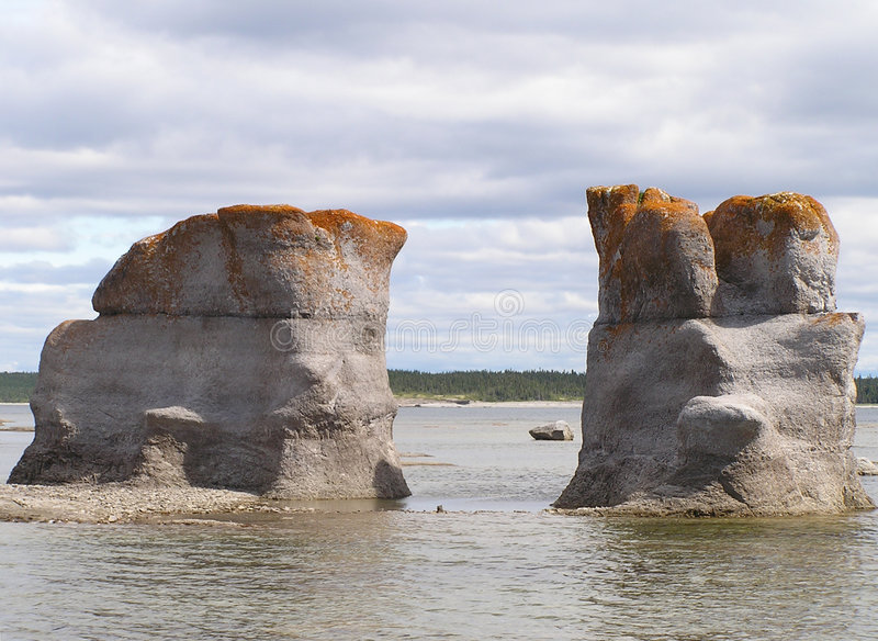Granitic islets and reefs. Details of granitic islets and reefs of Archipelago Mingan in the St. Lawrence River, Quebec, Canada stock photography