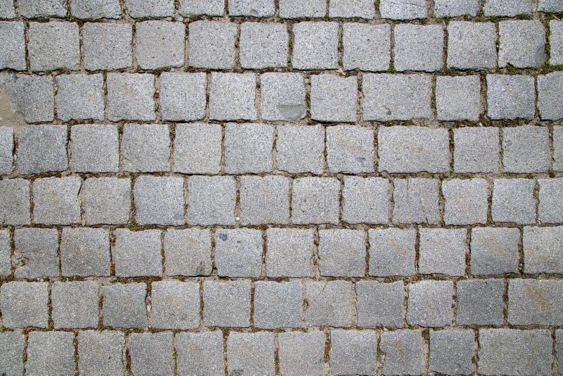 Granito do pavimento que pavimenta a vista de cima das cores cinzentas imagem de stock