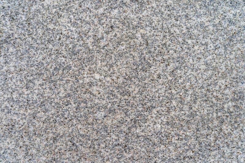 Granito grigio con i modelli fini - struttura/fondo di alta qualità fotografia stock