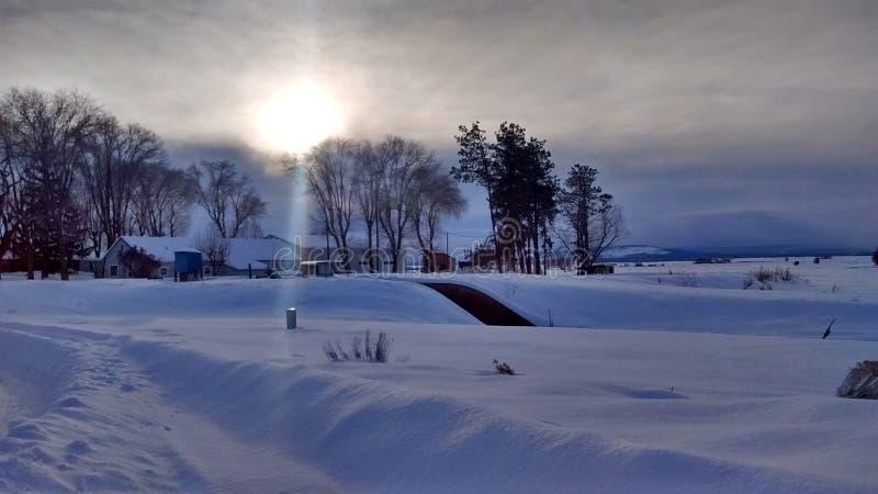 Granja nevosa central de la puesta del sol de Oregon imagen de archivo