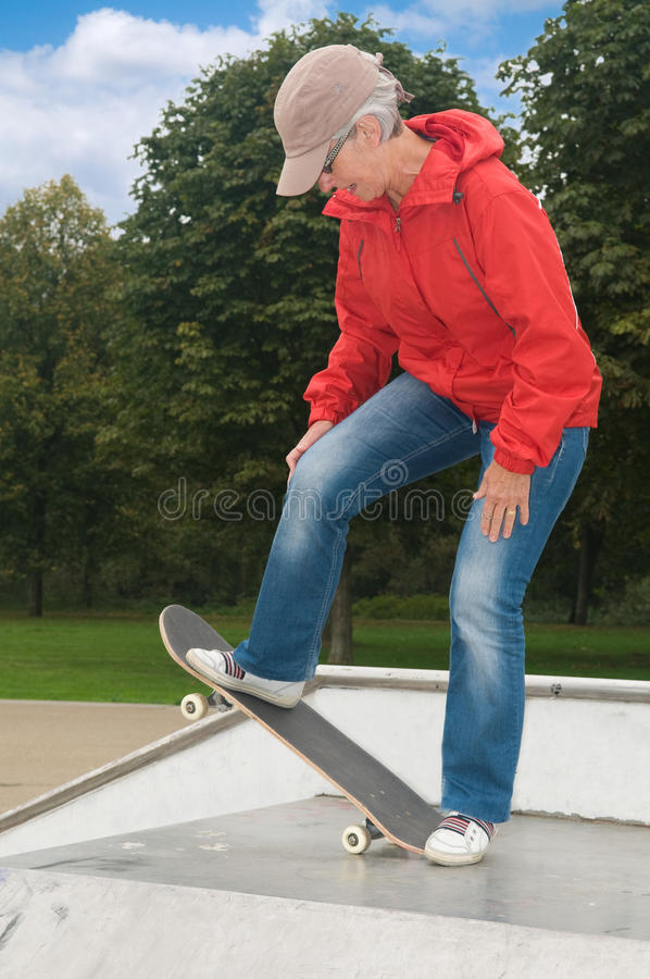 Granny on a skateboard stock images