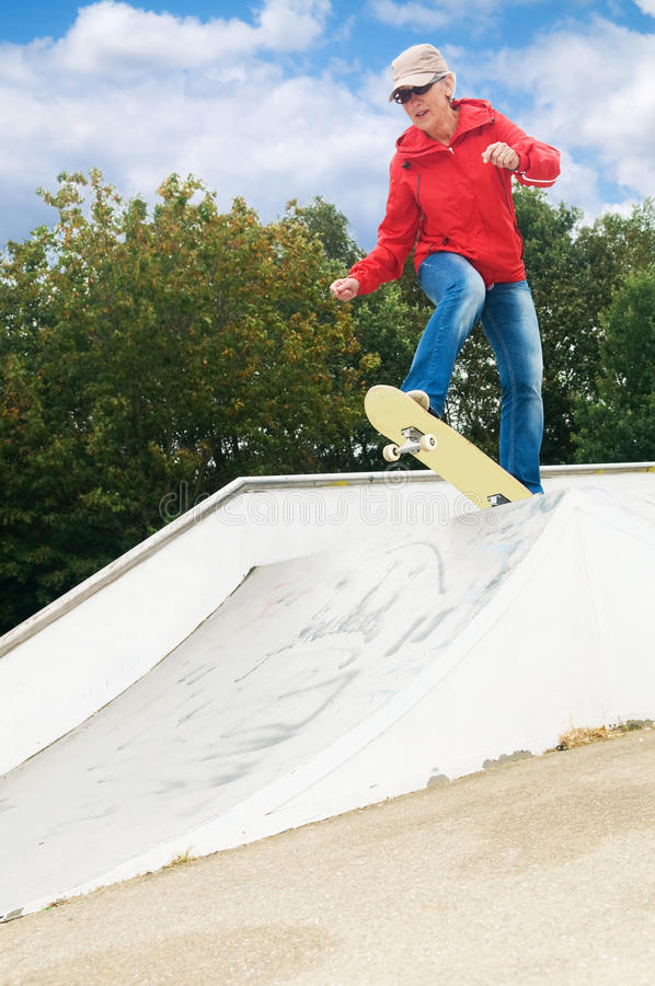 Granny on a skateboard royalty free stock photos