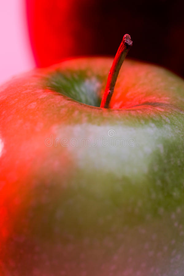 Granny Smith Apple with Red backlighing stock photos