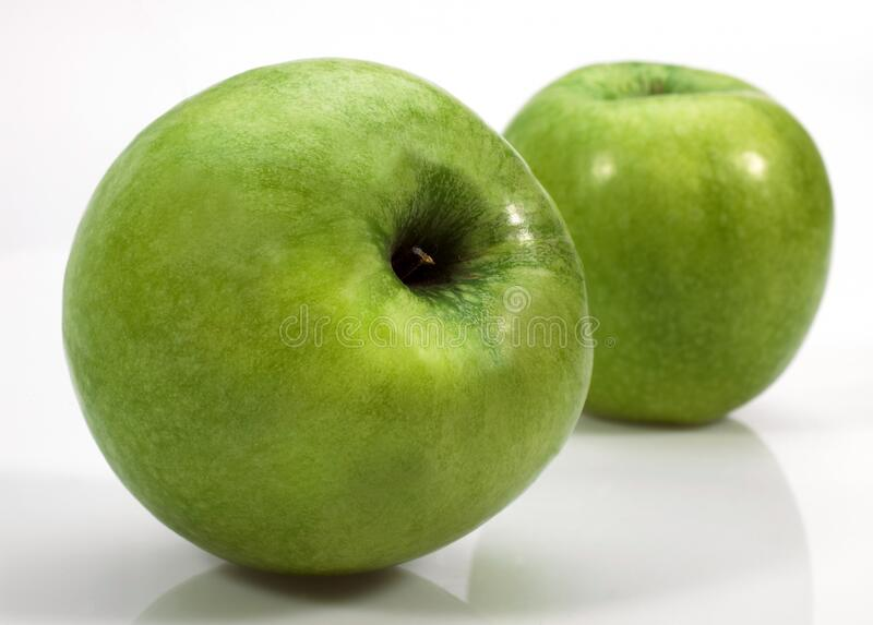 GRANNY SMITH. Apple, malus domestica, Fruits against White Background royalty free stock photo