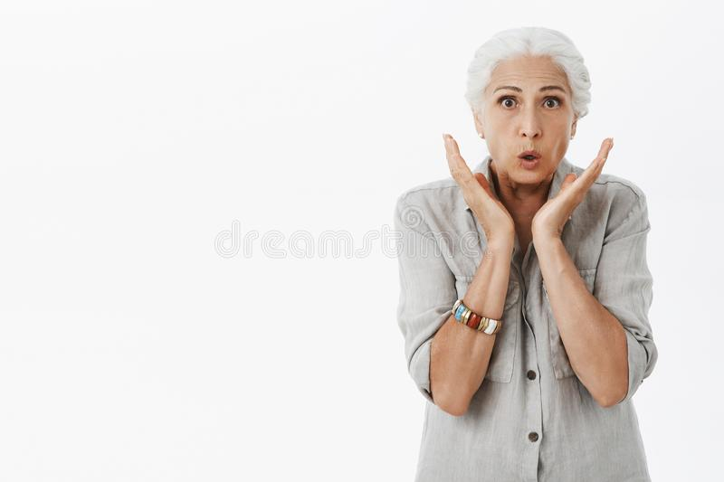 Granny worried son got thin. Portrait of nervous shocked and concerned kind charming senior woman with white hair stock photo