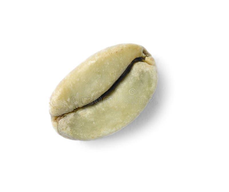 Grano de café verde en el fondo blanco, foto de archivo