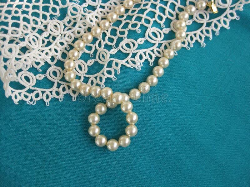 Grano y cordón de la perla imagenes de archivo
