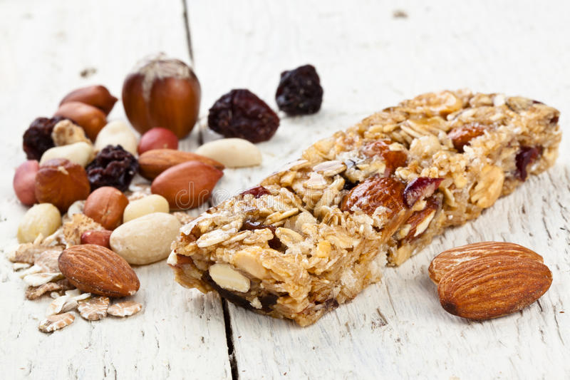 Granola Bar. With ingredients of hazelnuts peanuts almonds stock photography