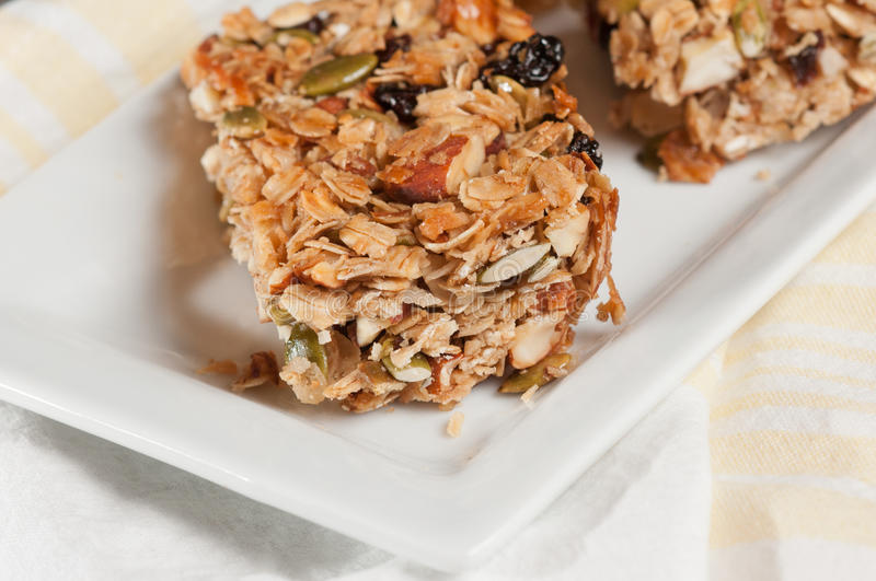Granola Bar. Baked granola Bar on a white plate-healthy option stock photography