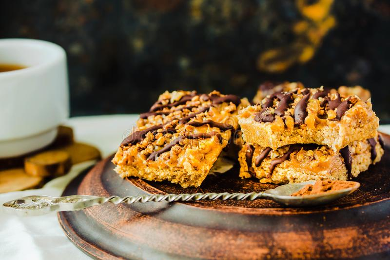 Granola bar cake with date caramel and chocolate. Healthy sweet dessert snack. Cereal granola bar with nuts, fruit and berries on stock photo