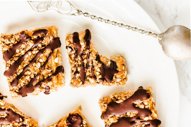 Granola bar cake with date caramel and chocolate. Healthy sweet dessert snack. Cereal granola bar with nuts, fruit and berries on stock images