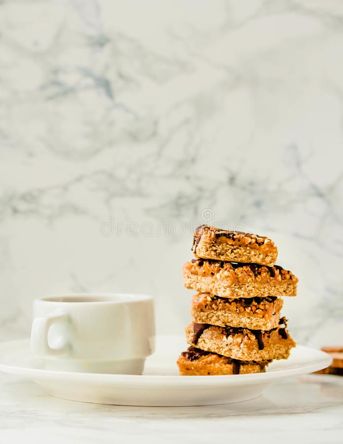 Granola bar with date caramel and chocolate. Healthy sweet dessert snack. Cereal granola bar with nuts, fruit and berries on a royalty free stock photography