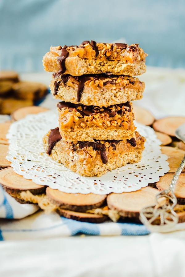 Granola bar with date caramel and chocolate. Healthy sweet dessert snack. Cereal granola bar with nuts, fruit and berries. Healthy stock photos