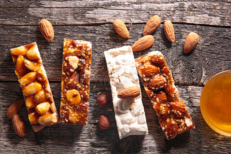 Granola bar. On wood background stock images