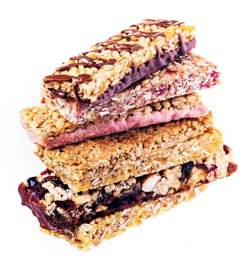Granola bars with cereals and dried fruit isolated stock photography