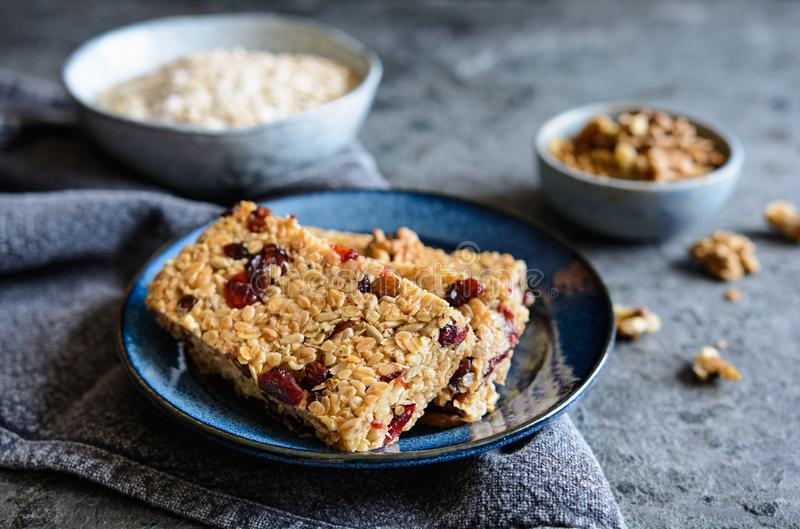 Granola bars with cranberries, walnuts, sunflower seeds and raisins. Healthy granola bars with cranberries, walnuts, sunflower seeds and raisins stock photos