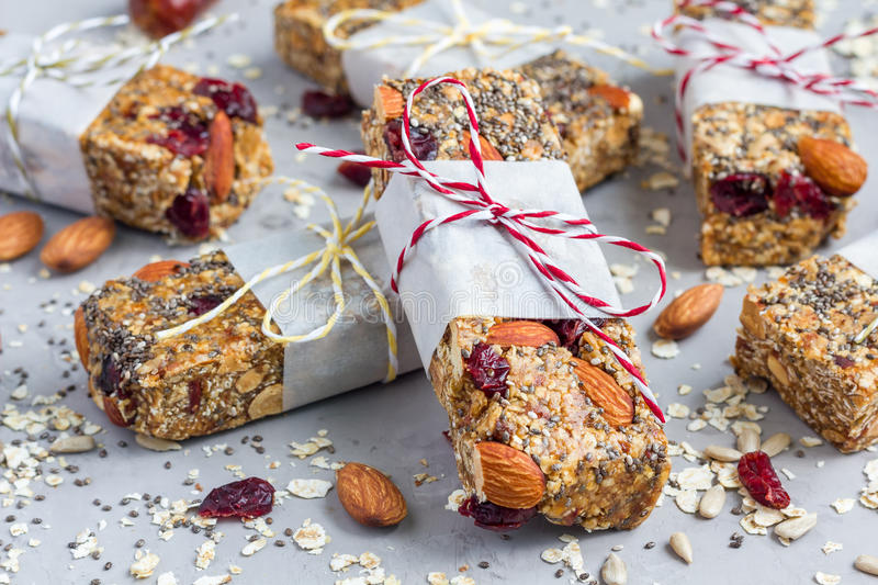 Granola bars with figs, oatmeal, almond, cranberry, chia, sunflower seeds stock photos