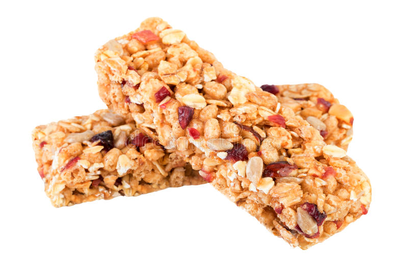 Granola bars isolated on white. Granola ingredients oats, dried cranberries, nuts, sunflower seeds, honey royalty free stock image
