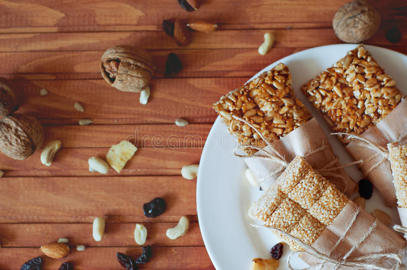 Granola bars made of sesame seeds, peanuts, cashew nuts. royalty free stock photo