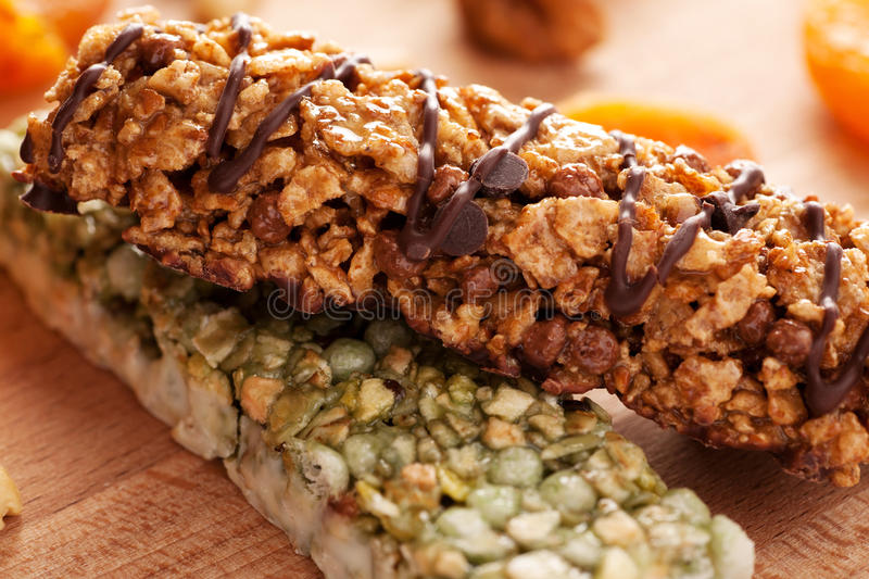 Granola bars on wooden board with fruits stock image