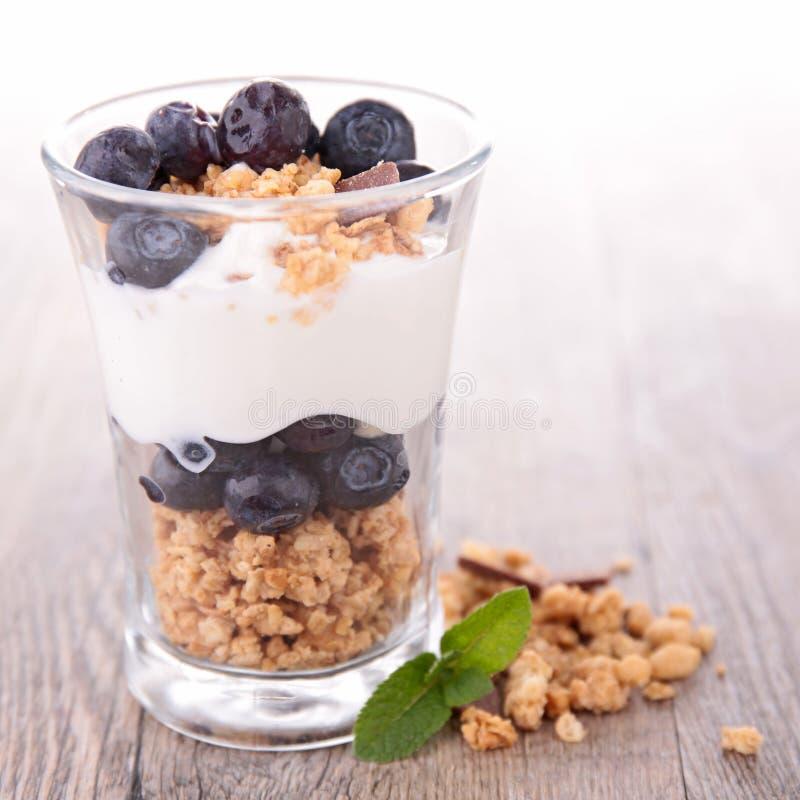 Granola, berries and yogurt stock photos